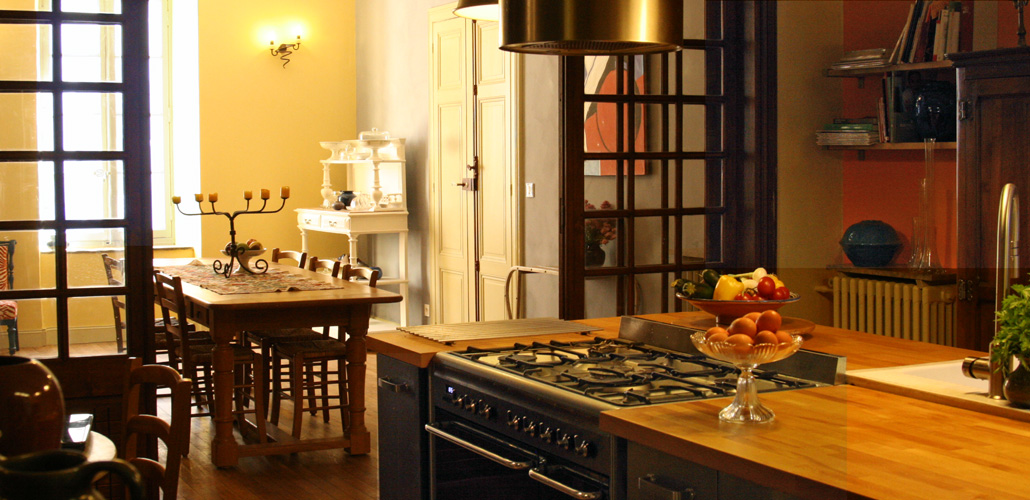 The dining room opens on the kitchen